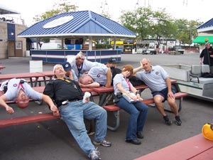 Meet Goolsby's enthusiastic Festivals Crew. From left. Bald guy, guy with cap on backwards, guy with blue cap, guy with white cap, guy on table, guy with hands over eyes, girl, and guy on the right.